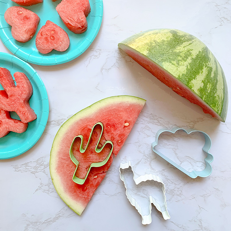 Cut watermelon with cookie cutters