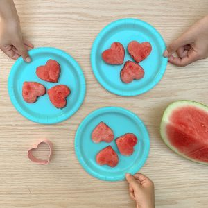 watermelon cut into heart shapes on a plate